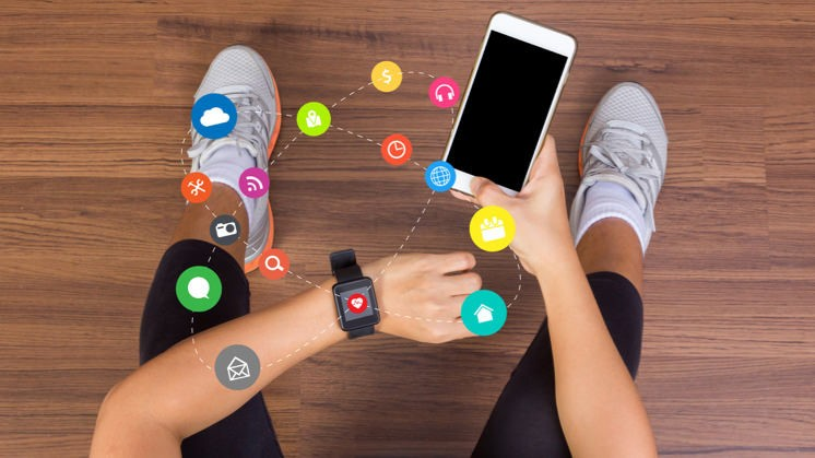 How can wearable devices be used to promote and track both physical and financial health?